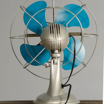 Vintage fan. Silver and blue tilting and osculating Westinghouse fan.
