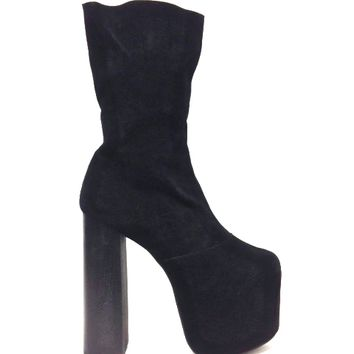 This sky high bad-girl ankle booties by Jeffrey Campbell, feature genuine suede upper with soft black color leather underling, hidden platform, and thick wooden heel, slit with elastic at ankle for your comfort fits, and a side zipper closure.