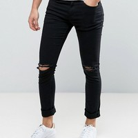 New Look Skinny Jeans With Knee Rips In Black at asos.com