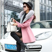 Long Woolen Coat. Fur Collar
