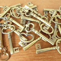 Brass tone metal skeleton keys between 3 and 4.25  inches long for crafting, display.  Sold individually