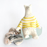 Little Ceramic Polar Bear in White Clay and Decorated with Yellow Stripes