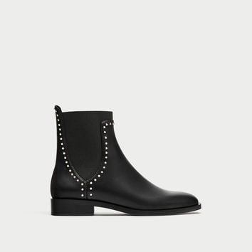 FLAT ANKLE BOOTS WITH STUDS DETAILS