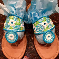Hand painted sandals inspired by the style of Jack Rogers and painted in a Lilly Pulitzer inspired poolside blue floral pattern.