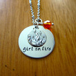 "Hunger Games Inspired Necklace. Katniss ""girl on fire"". Hand stamped, silver colored, charm pendant, Swarovski crystal, jewelry."