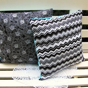set of 2 envelope style 18 x 18 pillow covers. black and white with contrast Tiffany blue backside. black white chevron. black white floral