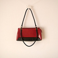 Vintage. Italian. 'Sagi' Dark Red and Black Shoulder Bag. Purse. Handbag. Genuine Leather. Zipper. Gold Hardware. Classic. Made in Italy.