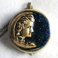 Music box locket, round locket with music box inside, in bronze with maiden in the moon on front cover