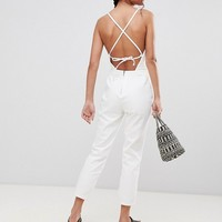 ASOS DESIGN denim halterneck jumpsuit in white at asos.com