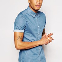 ASOS | ASOS Skinny Denim Shirt With Short Sleeves In Mid Wash at ASOS