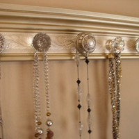Available in 3 sizes with 5,7 or 9 Knobs. Champagne Gold Jewelry Organizer.