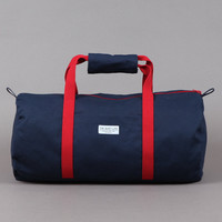 THE QUIET LIFE SHUTTLE BAG NAVY / RED