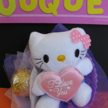 Hello Cute Kitty Plush Doll with Ferrero Rocher Chocolate in a mini Flower Bouquet. Perfect party favor or sweet little gift for her!