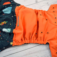 Orbiting The Planets, PK (Orange outer, two-toned snaps- Black caps/Orange pieces) Wrap Around, OS Pocket DiaperInstock and ready to ship