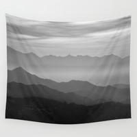Misty mountains Wall Tapestry by Guido Montañés