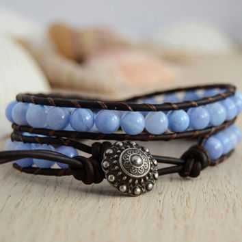 Hippie style beaded jewelry. Leather bracelet. Cornflower blue beads