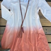 Our Out Of Reach Tunic Dress is an adorable baby doll tunic dress with 3/4 sleeves. Made of jersey like material and has scoop neckline with dip dye ombre effect. Unlined.