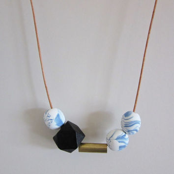 NL-028 White and Blue Round Polymer Clay and Black Geometric Wood Bead with Brass Tube Necklace in Adjustable Leather Cord