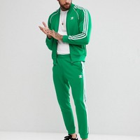 adidas Originals adicolor Tracksuit in Green at asos.com