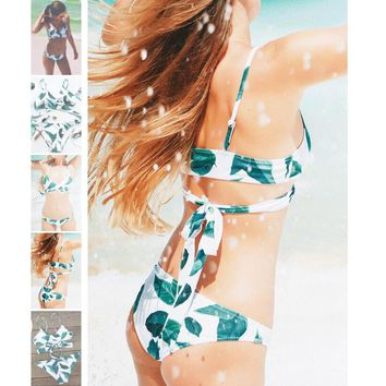 Background white with green leaf print chest straps cross two piece bikini