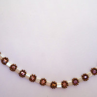 Choker with antique ivory pearl tile beads,fire mountain gems in crystal and copper, and copper seed beads. Handmade.
