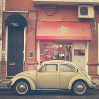 Beige Volkswagen Bug and a lovely Pink Shop (Vintage - Retro Urban Photography) Art Print by AC Photography