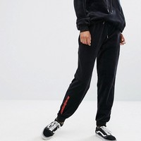 Wasted Paris Relaxed Joggers With Logo In Velour Tracksuit at asos.com