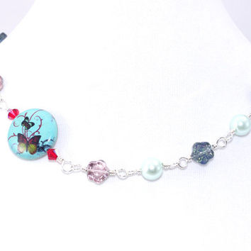 Blue butterfly round stone sterling silver fill wire wrap necklace Pale green faux pearl Red Swarovski crystal Pink Czech glass flower bead