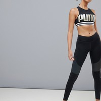 Puma Ambition Bra In Black And Gold at asos.com