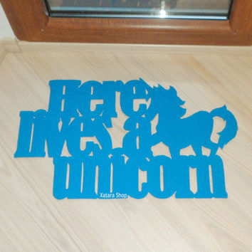 "Doormat ""Here lives a unicorn"". Funny welcome mat"