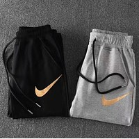 Nike Gold Logo Print Pants Sweatpants