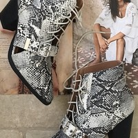 Stomp on Me Snakeskin Ankle Bootie
