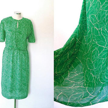 Green floaty leaf print dress / white / chiffon / semi sheer / vintage / 1980s / button collar / short sleeve / slouchy summer tea dress