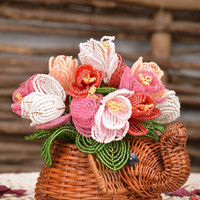 Decorative woven ornamental flowerpot for home with flowers made of beads