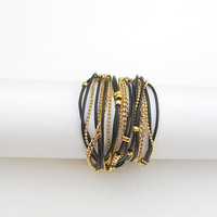 Two-in-one - Wrapped bracelet or necklace. Black round leather & gold plated chains and beads