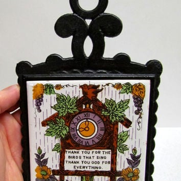 Vintage Trivet Hot Pad with Clock, flowers, and words painted on the ceramic tile