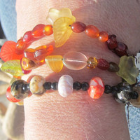 Carnelian, Czech glass flowers and leaves and antiqued verdigris charm stackable brass braceletTAGTMCTT