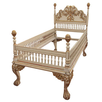 A painted and gilded wood bed