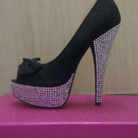 A pair of Glam Blinged up black peeptoe platform stilettos with bows