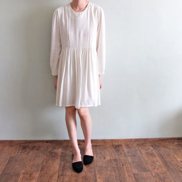 Vintage-inspired bohemian white eyelet peasant casual-fit dress with bishop sleeves