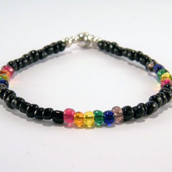 Black and Rainbow Seed Bead bracelet .. Gay Pride bracelet with black and rainbow glass seed beads and a magnetic clasp.
