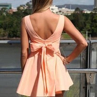 Approach Tie Bow Apricot  Bow Back Dress from xeniaeboutique