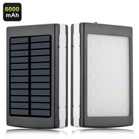 Outdoor Camping 6000mAh Portable Power Bank - Solar Panel, 2x USB Ports, Phone Adapters, Built-in LED Light, 4 Light Modes