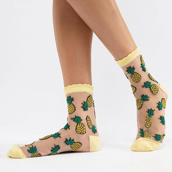 ASOS DESIGN sheer pineapple socks at asos.com