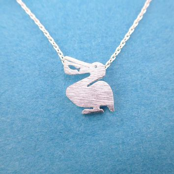Pelican Silhouette with Fish Cut Out Shaped Charm Necklace in Silver | DOTOLY