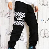 Vans sneaks through the classic black and white plaid pocket utility overalls with a loose-fitting, casual, all-male look