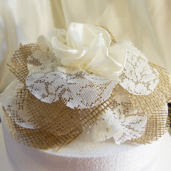 "Burlap Cake Topper Flower for wedding cake. Handmade of natural burlap, ivory lace and silk. Pics shown the flower on an 8"" round."