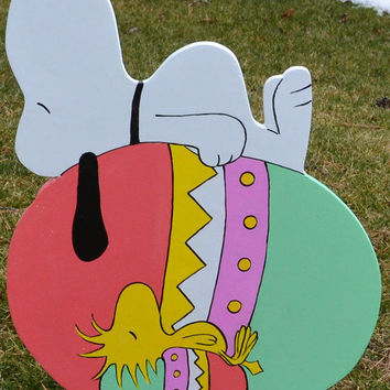 Snoopy and Woodstock sleeping on there Easter Eggs