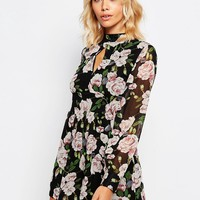 Fashion Union Long Sleeve Playsuit In Floral Print at asos.com