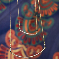 Clear Springs Gold Delicate Curved Bar Necklace
